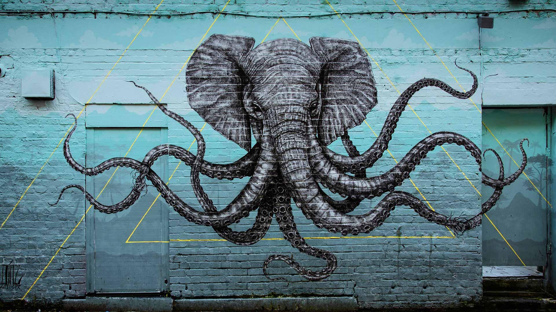 street art d'un éléphant avec des tentacules de pieuvres